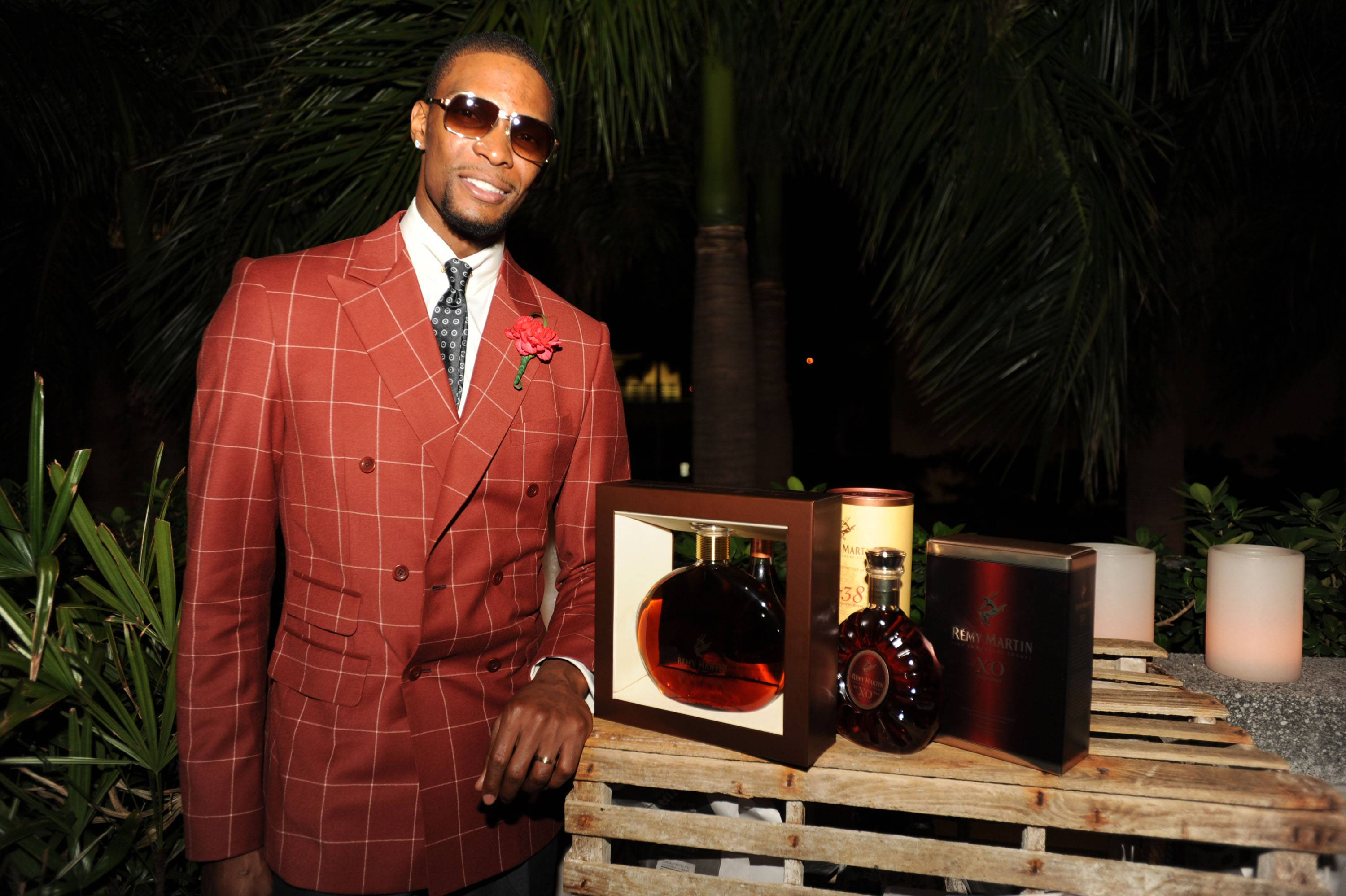 Chris Bosh with his birthday gift from Remy Martin, a discontinued bottle of Remy Martin Extra