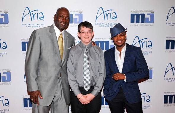 Michael Jordan, Ne-Yo and Make-A-Wish child Lucas on carpet at MJCI Celebration, Las Vegas, 3.30.12