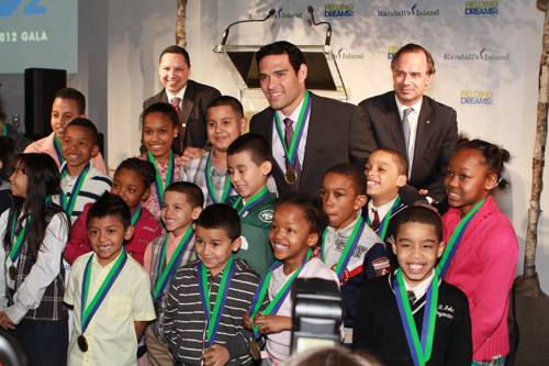 Mark Sanchez with the children from the Casita Maria Center for Arts