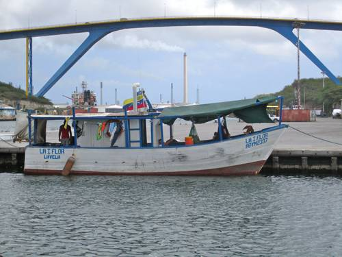 A fishing boat awaits an opening at the Floating Market in Curacao