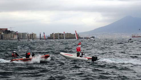 All nine teams at starting line against the back drop of Naples castle and Mount Visuvio.