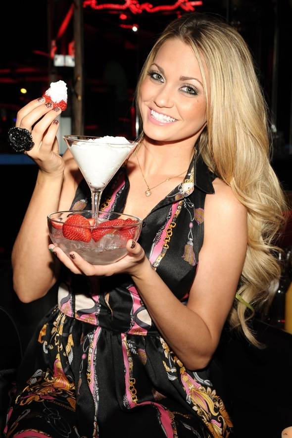 Angel Porrino with strawberries and whipped cream