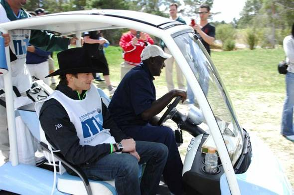 Caddy Ashton Kutcher and Michael Jordan riding in the MJ golf cart at MJCI, Las Vegas, 4.1.12