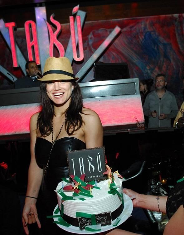 Gina Carano Standing with Cake-Tabu Ultra Lounge 4.21.12