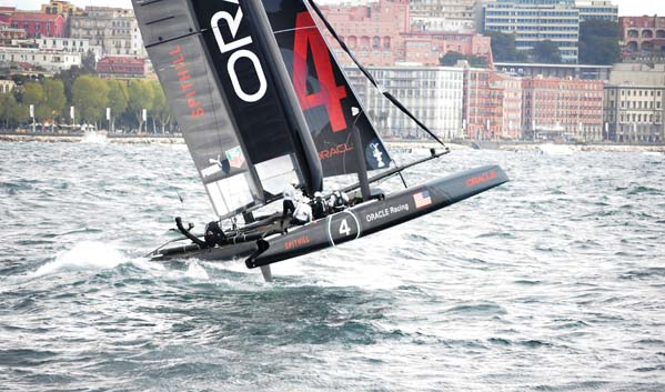 Oracle Spithill flying through the rough waves to win Day-one fleet race.