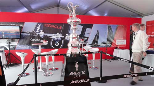 Tom Uhman, Vice Commodore of Golden Gate Yacht Club, defender of America's Cup showing the Cup at Oracle Racing lounge in Naples