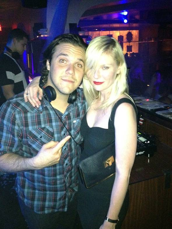 Kirsten Dunst and DJ DiJiTAL in Hyde Bellagio's DJ booth, Las Vegas, 5.18 - low