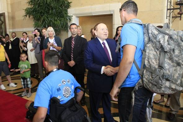 Mr. Adelson greets wounded veteran