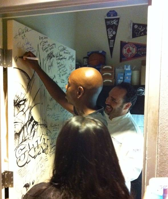 Dave Chappelle with Chef Barry sighing N9NE's shake down door 6.27.12