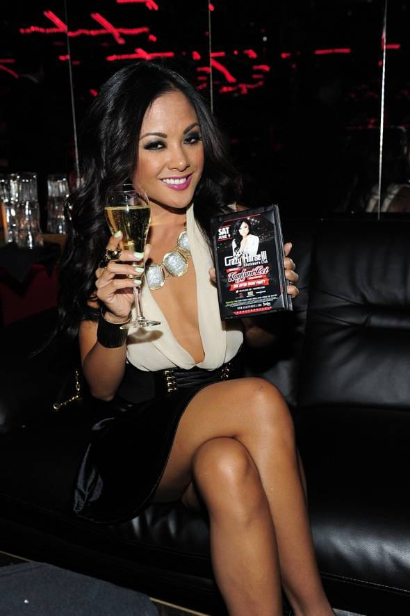 Kaylani Lei with event flyer