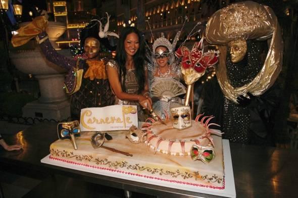 Kimora Lee Simmons cuts cake at Carnevale at The Venetian