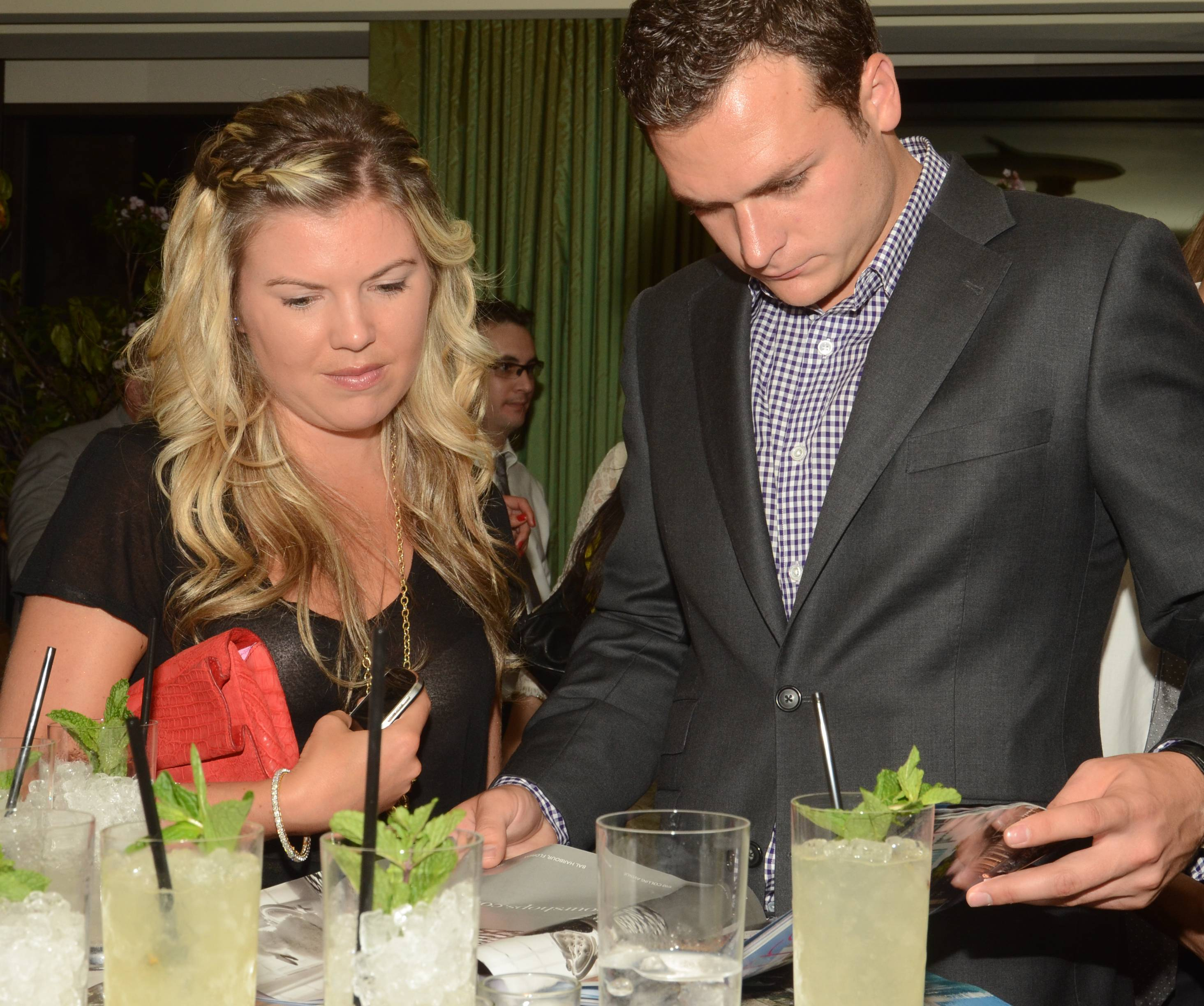 Party Guests Browse Premiere Issue of Ultratravel U.S.
