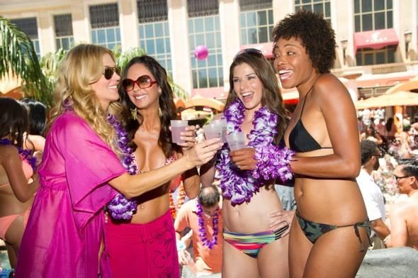 Brandi Glanville toasts her girlfriends with Hpnotiq Harmonie at TAO Beach