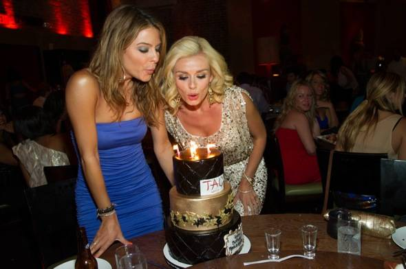 Maria Menounos and Katherine Jenkins blow out candles at TAO