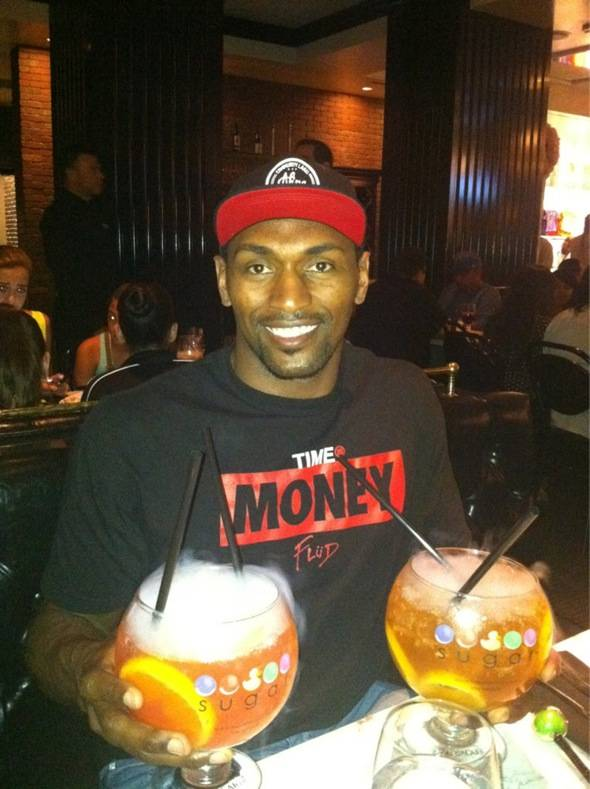 Metta World Peace Enjoying a Passion Punch Goblet