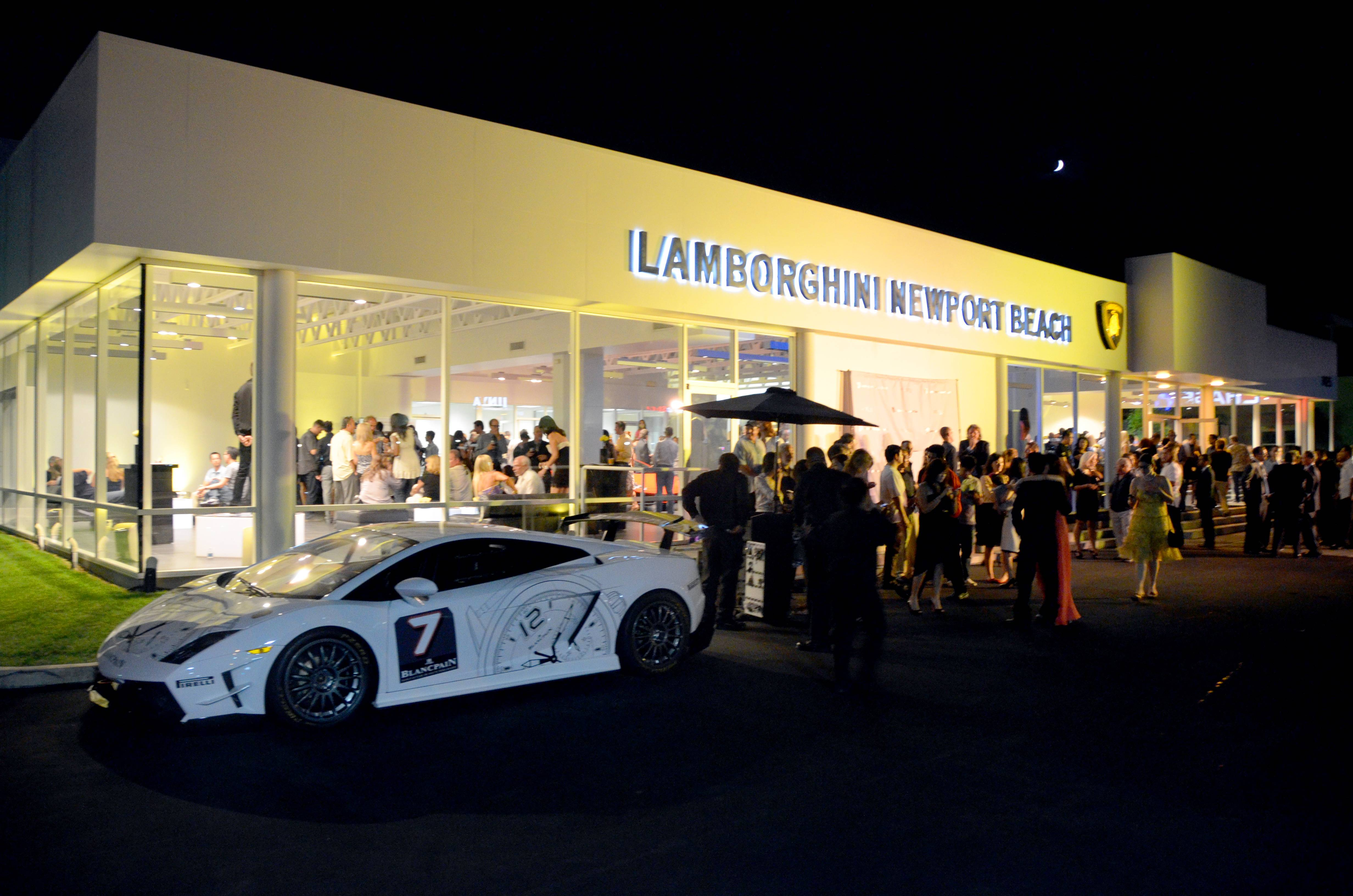 Lamborghini Newport Beach - Dealership and Lamborghini Gallardo Super Trofeo (left)