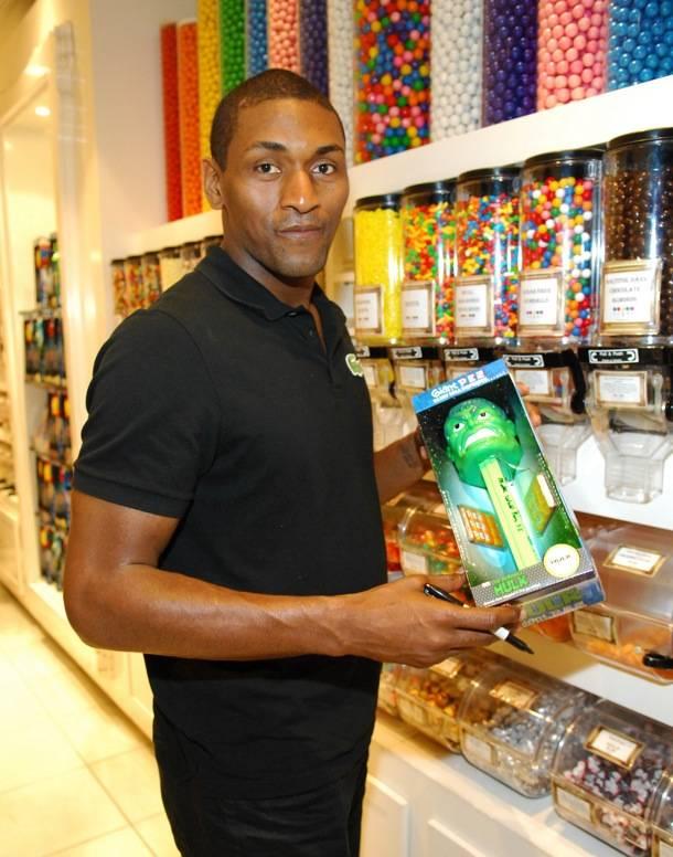Metta World Peace signing a Hulk PEZ dispenser at Sugar Factory