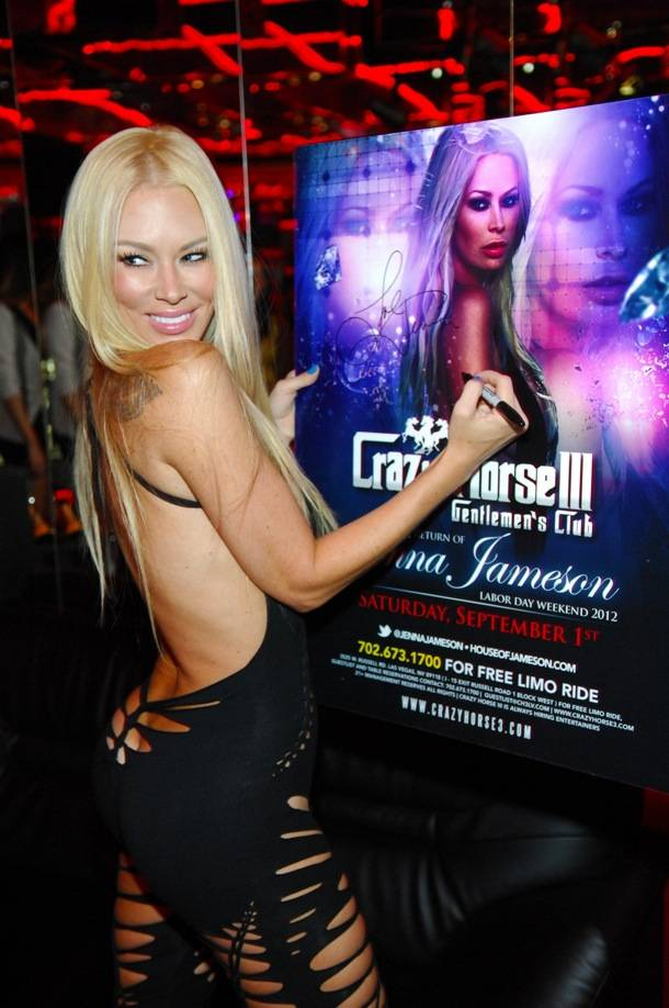 Jenna Jameson signing a poster for fans
