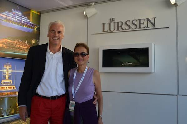 Olivia and Peter Lurssen with images of 147 meter Topaz, the newest yacht built by Lurssen.