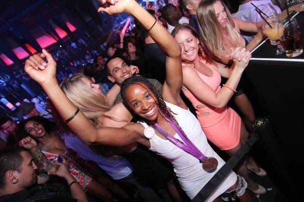 Olympian Janay DeLoach dancing with her Bronze Medal at Rain Nightclub in Las Vegas 9.1.12
