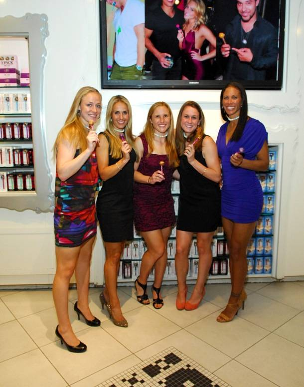 Team USA Womens Soccer Team Poses With Couture Pops Inside Sugar Factory Retail
