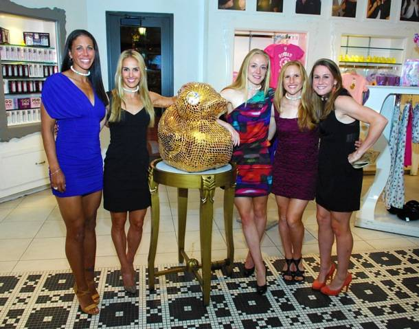 Team USA Womens Soccer Team Poses With Golden Duck Inside Sugar Factory Retail