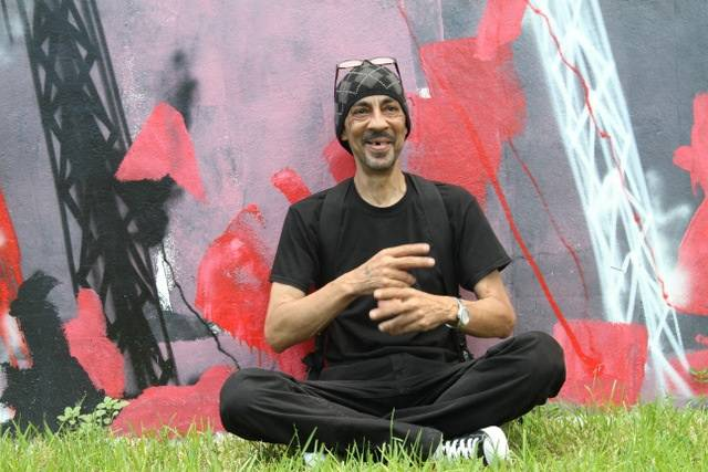 Futura sitting in front of his work at wynwood walls  - 2