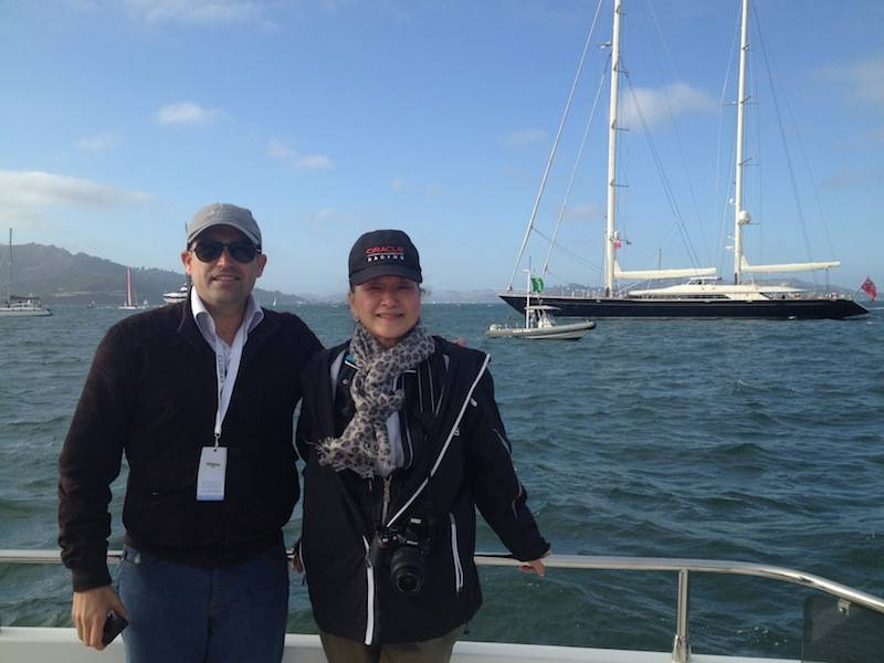 Seth Semilof and Olivia Decker, Larry Ellison's yacht Asahi in the background