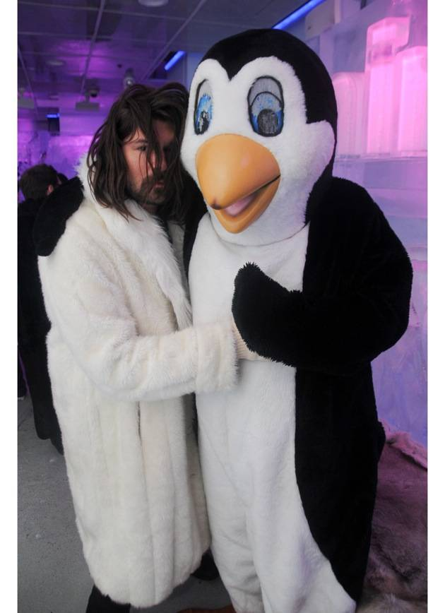 Taking Back Sunday lead vocalist Adam Lazzara with Slushy the Penguin