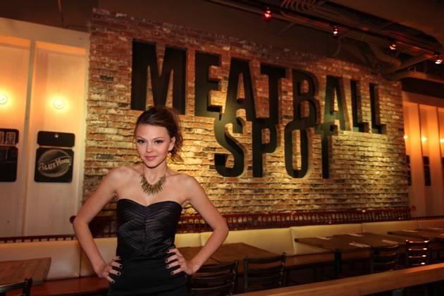 Aimee Teegarden Poses Under Meatball Spot Sign