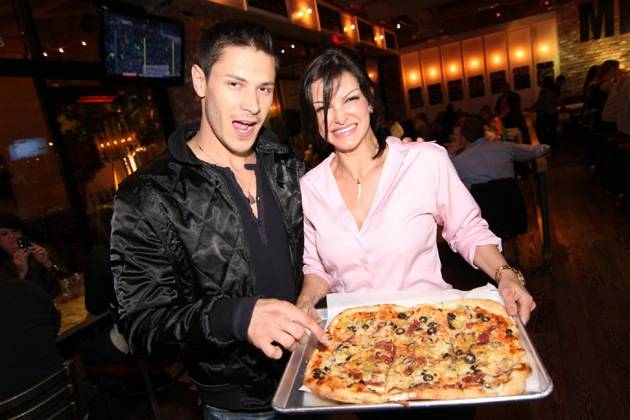 Alex Meraz enjoying a pizza with Chef Carla Pellegrino at Meatball Spot.