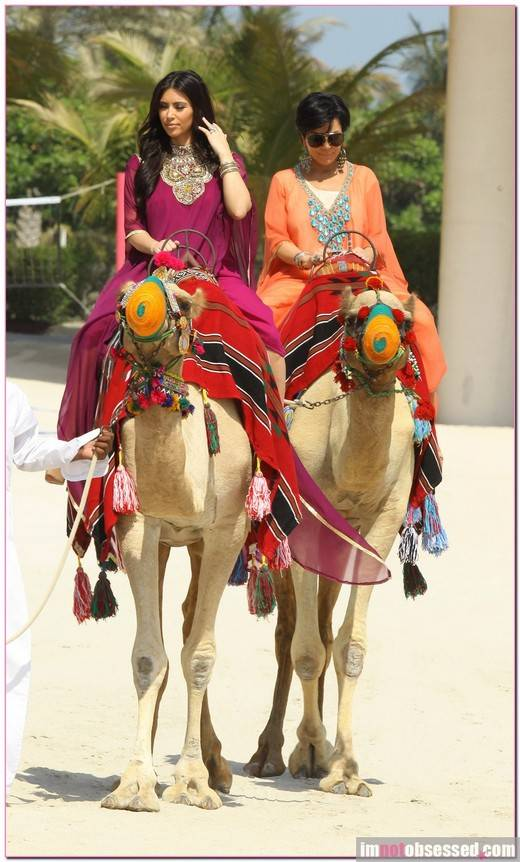 Kim Kardashian rides a camel with her mom at the Atlantis resort in Dubai