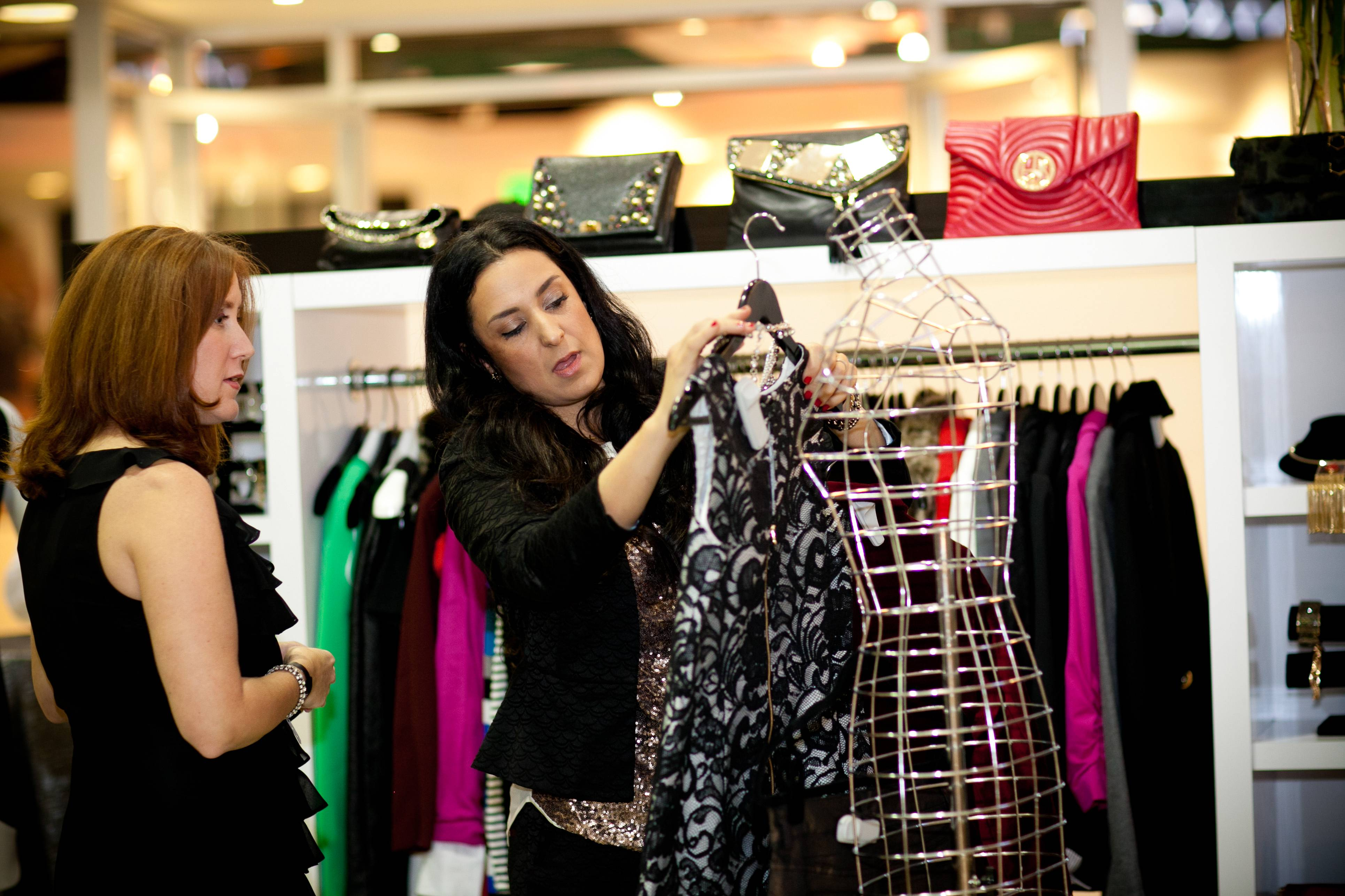 Fashion blogger Hasti Khshfia gives style advice to Couture Funding a Cure guest in the pop-up Mode Bay Area Style Lounge credit Moanalani Jeffery Photography