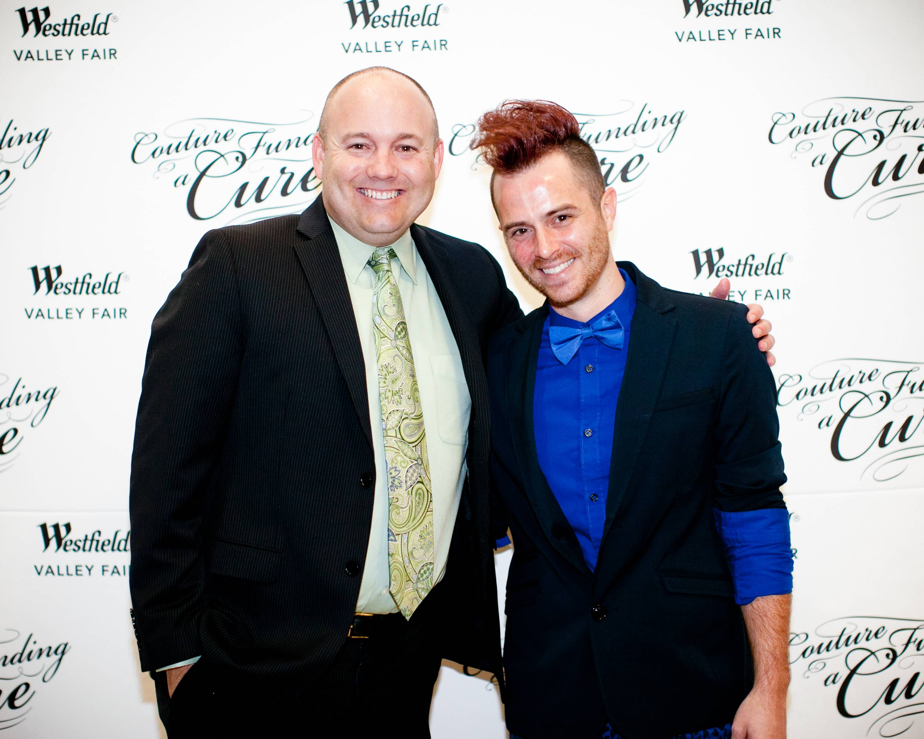 Gavin Farnam, Westfield Valley Fair Senior General Manager, and Anthony Ryan Auld, Project Runway All Star designer pose together on red carpet.credit Moanalani Jeffery
