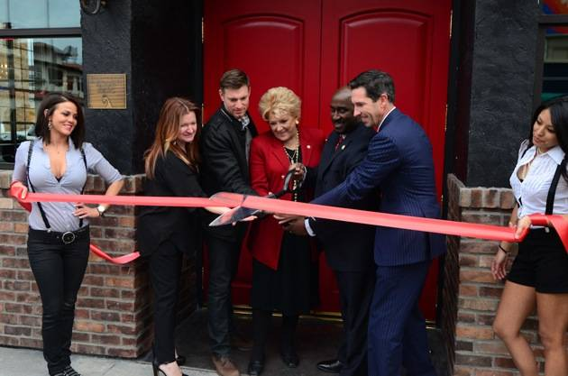 Kenna Warner, Ryan Doherty, Mayor Carolyn Goodman, Councilman Ricki Barlow and Mike Parks cut the red ribbon at Commonwealth
