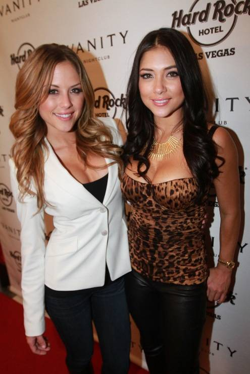 UFC Octagon Girl Arianny Celeste poses with fellow Octagon Girl Brittany Palmer on Vanity Nightclub's red carpet 12 15 12lr