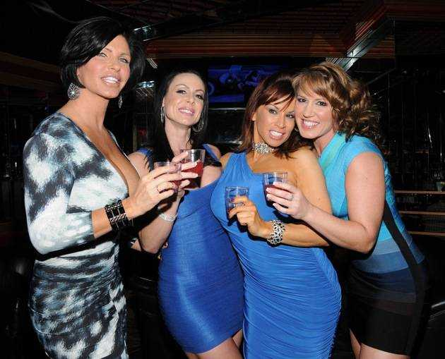 Adult film actresses toasting
