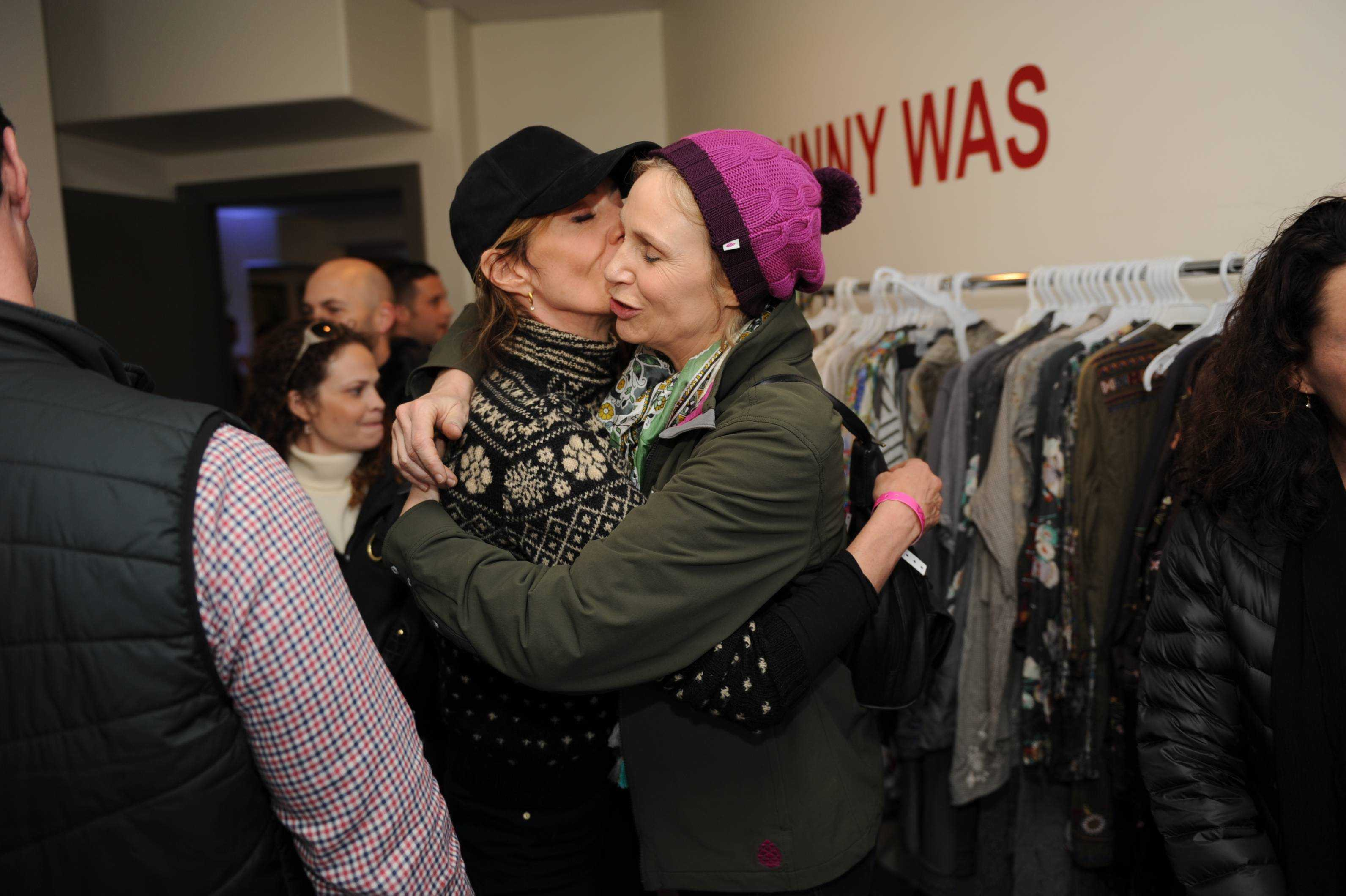 Allison Janney and Jane Lynch hugging at the Miami Lounge at Sundance