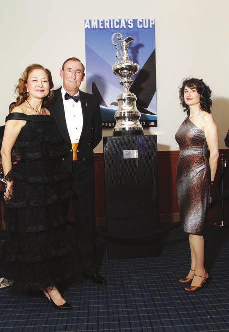 Norbert Bajurin with the America's Cup on display during the Commodore's Ball