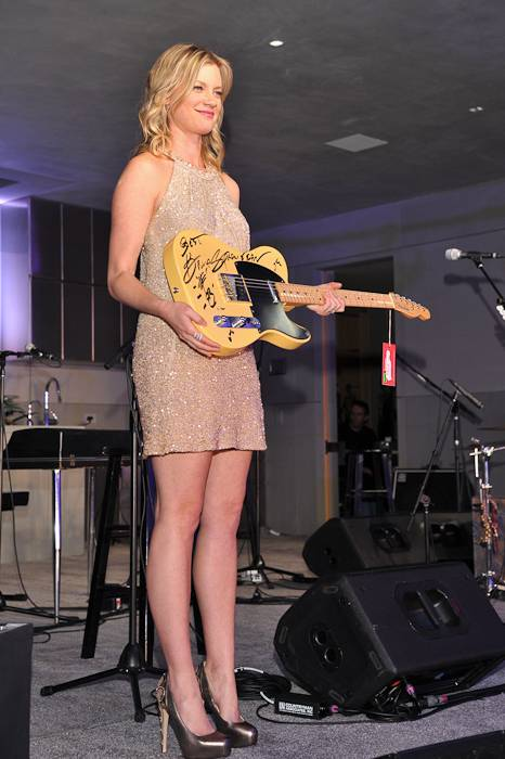 12a Amy Smart with Bruce Springsteen guitar