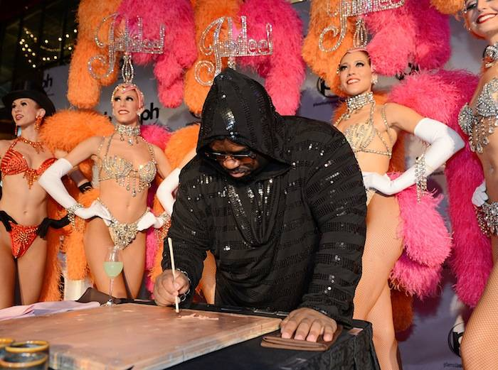 CeeLo Green Plays Flaming Piano Down Las Vegas Strip As He Arrives To Planet Hollywood Resort & Casino