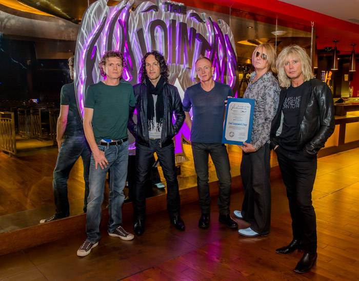 Def Leppard Pose with Official 'Def Leppard Day' Proclamation 3.22.13
