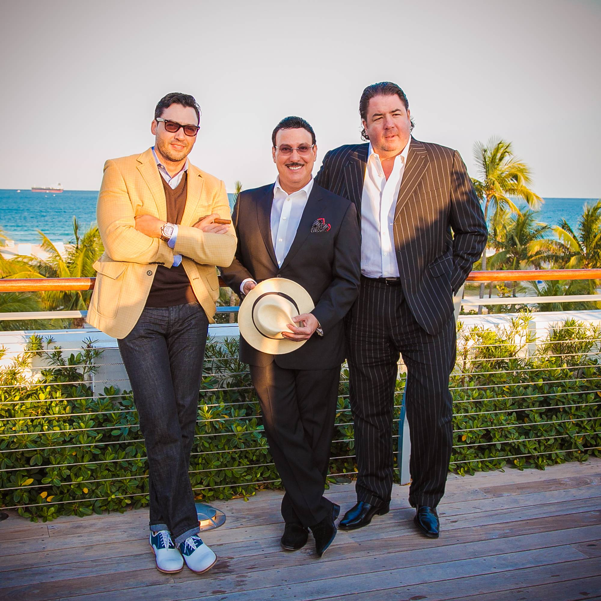 Manny Iriarte, of Iriarte Photography & Design, Carlos Fuente Jr, president of Arturo Fuente Cigars & Michael Bulnes, of Selecta Magazine