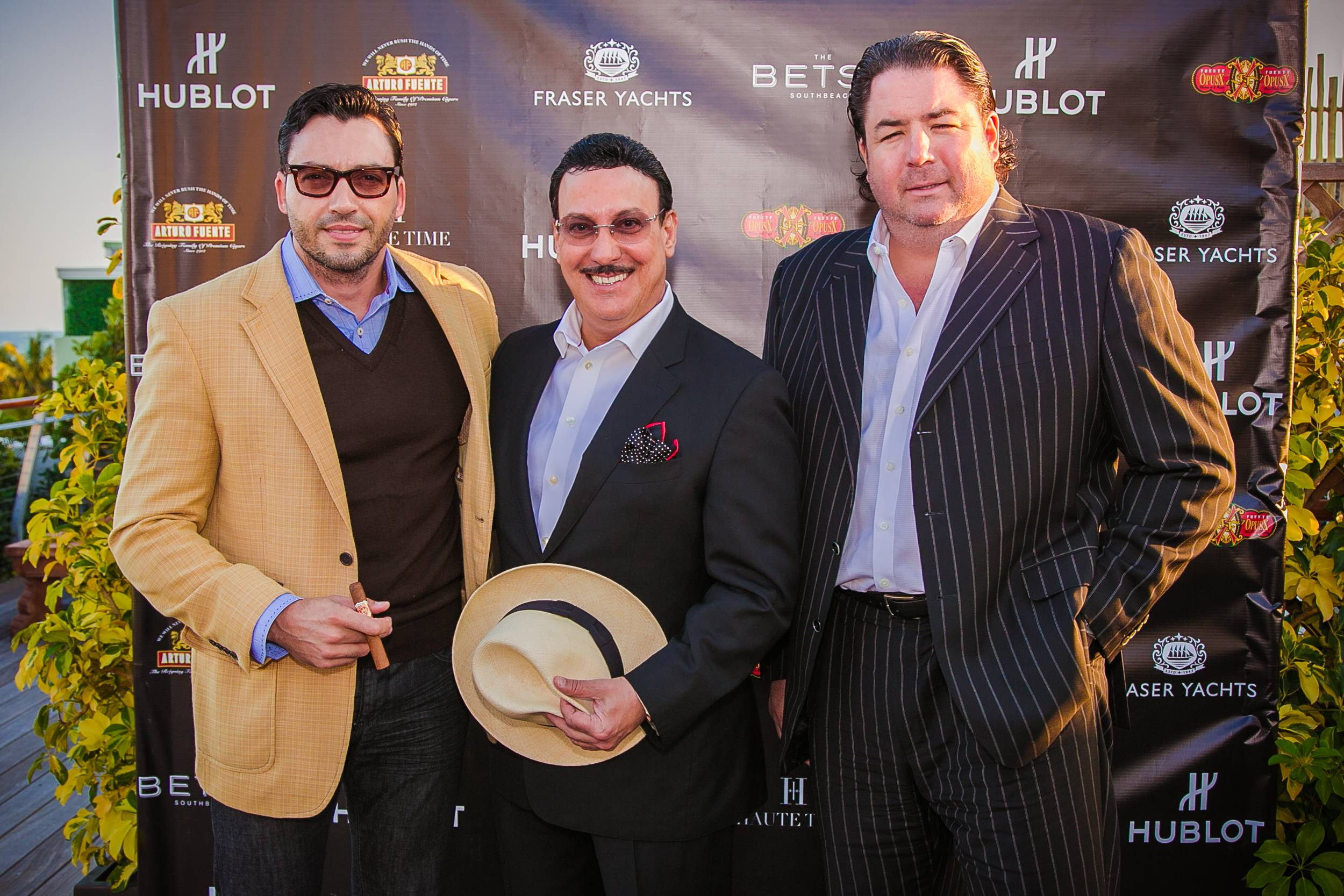 Manny Iriarte, of Iriarte Photography & Design, Carlos Fuente Jr, president of Arturo Fuente Cigars and Michael Bulnes, of Selecta Magazine