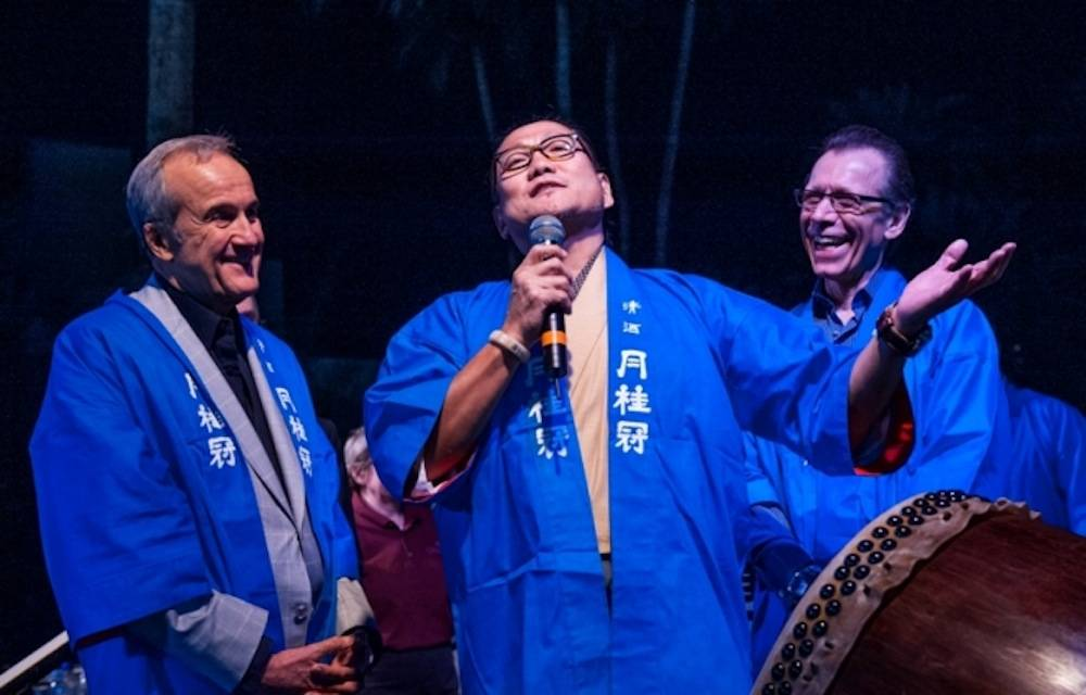Chef Masaharu Morimoto sings while Larry Ruvo and Michael Severino look on at UNLV Sake Fever, 4.19.13, Tom Donoghue Photography