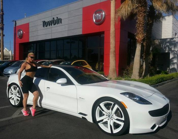 Coco Austin with Fisker Karma at Towbin Automotive dealership