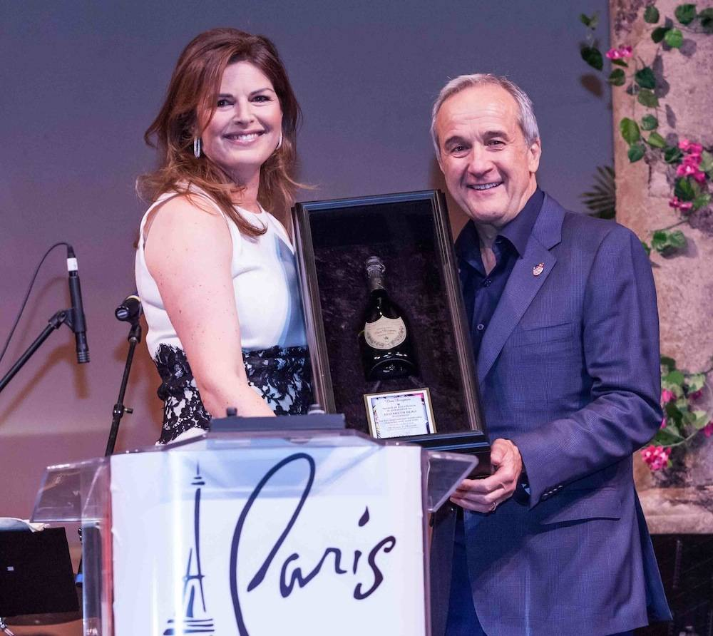 Elizabeth Blau accepting Dom Perignon Award of Excellence from Larry Ruvo at UNLVino's Grand Tasting, 4.20. 2013