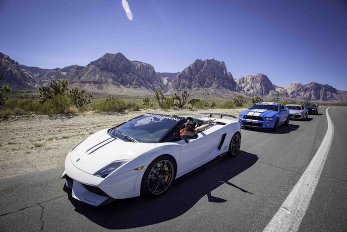 Travis Cloer leading the line of World Class Driving's Super Car fleet; ...