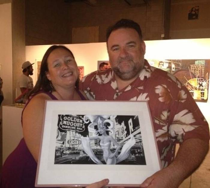 Wendy & Mark Wallington with their piece of art purchased at Framing Hope
