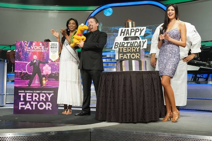 Miss USA 2012, Nana Meriwether and Taylor Makakoa present a birthday cake onstage to Terry Fator during the Terry Fator: The Voice of Entertainment show at the Mirage, Las Vegas in Las Vegas, Nevada on Monday June 10, 2013.  She will spend the next week touring, filming, rehearsing, and making new friends while preparing to compete for the coveted Miss USA Diamond Nexus Crown. Tune in to the crowning moment LIVE on NBC starting at 9:00 PM ET on June 16th, 2013 from PH Live.